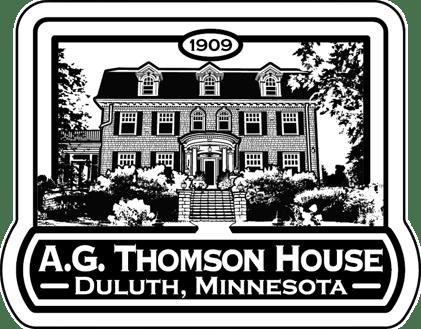 AG Thomson logo on medallion