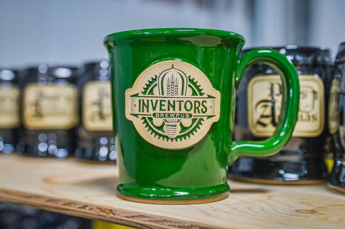 Green stoneware mug for Inventors Brewpub