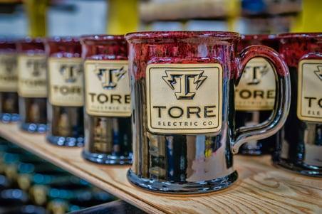 Tore Electric Co. Mugs