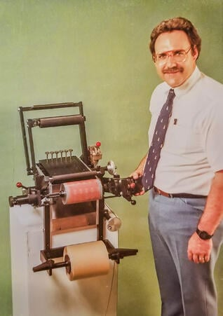 Duane Dunsirn with machinery he invented c. 1970s