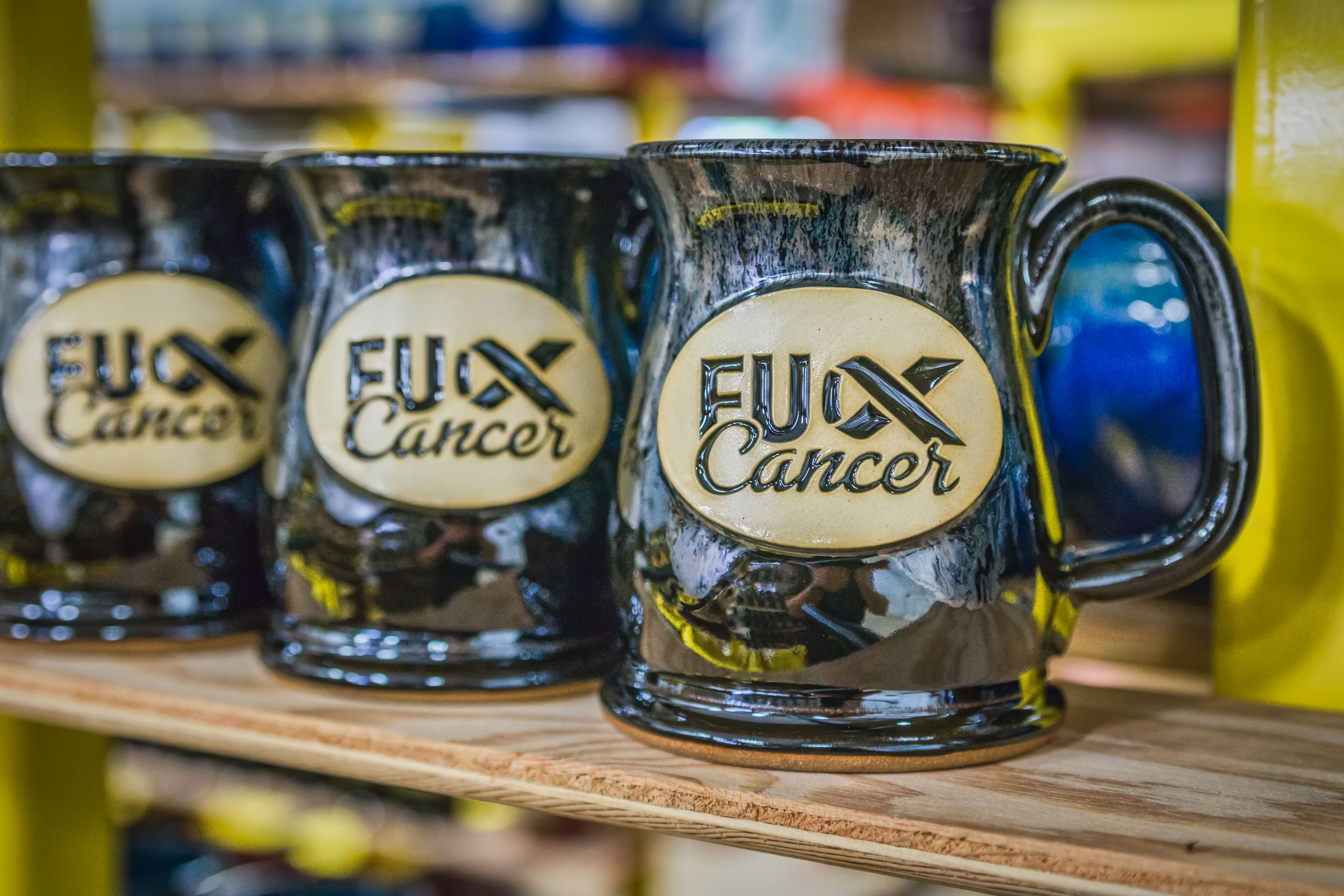Sunset Hill Stoneware says FU Cancer with new mug